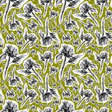 Hand drawn graphic seamless pattern of cut out white silhouettes and black ink sunflowers on a dirty lime background stock photography