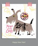 Year of the Dog 2018. Hand drawn greeting card with a funny dog and a Christmas ball. 2018. Happy New Year Stock Photos