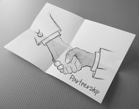 Hand drawn handshake sign as partnership Stock Image