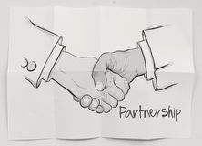 Hand drawn handshake sign Stock Photos