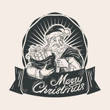 Hand-drawn happy Santa Claus and bag with gifts Royalty Free Stock Photo