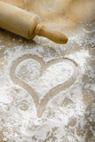 Hand drawn heart in flour Stock Photo