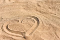 Hand drawn heart on sea sand on the beach royalty free stock photos