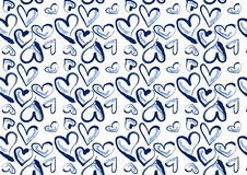 Hand drawn hearts in blue denim. A background composition of hand drawn heart in blue denim Stock Image