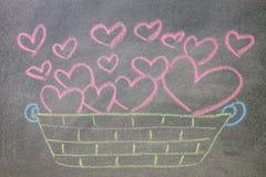Hand drawn hearts on chalkboard background. Hand drawn pink hearts on chalkboard background vector illustration
