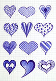 Hand drawn hearts on the sheet of checkered paper Stock Photography
