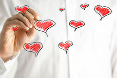 Hand-drawn hearts on a Valentines greeting card Stock Image