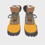 Hand drawn hiking boots vector sketch isolated Stock Images