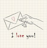 Hand drawn hand holding a lovely letter envelope on mathematical square paper. With the text I love you Stock Photography