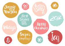 Hand drawn holiday lettering in grunge style circles . Christmas collection of unique lettering for greeting cards, stationary. Stock Photography