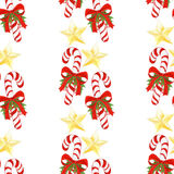 Hand drawn holiday pattern with Christmas candy canes,golden stars,bows,holly leaves and berries. seamless background in Stock Photo