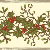 Hand drawn  holly twigs and mistletoe seamless border Royalty Free Stock Images