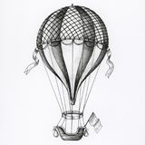 Hand drawn hot air balloon isolated on background Stock Photo