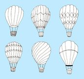 Hand drawn hot air baloons set on blue background royalty free illustration