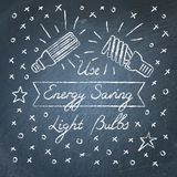Use Energy Saving Light Bulbs lettering on chalkboard Stock Image