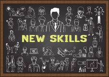 Hand drawn icons about NEW SKILLS on chalkboard Stock Photo