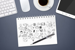 Hand drawn icons on office background. Hand drawn icons on a white paper on office background Royalty Free Stock Photos