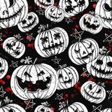 Halloween seamless pattern with evil pumpkin heads and bloody drops vector illustration