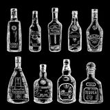 Hand drawn illustration of different bottles isolate on dark background. Vector pictures set Royalty Free Stock Photo