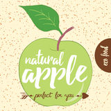 Hand drawn illustration of  green apple silhouette on a beige background. Typography poster with creative slogan. Stock Images