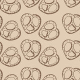 Hand drawn illustration of pretzels, seamless pattern on beige background Royalty Free Stock Images