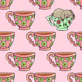 Hand-drawn illustrations. Bright teacups. Postcard cute funny fell asleep in a cup. Seamless pattern. Royalty Free Stock Photography