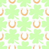 Hand-drawn illustrations. Happy day with a horseshoe and clover. Seamless pattern. Stock Photography