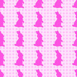 Hand-drawn illustrations. Pink bunny on a polka dot background. Seamless pattern. Royalty Free Stock Photo