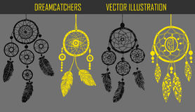 Hand-drawn with ink dreamcatchers with feathers. Stock Images