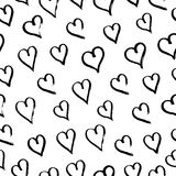 Hand drawn with ink seamless pattern with black hearts. Abstract grunge seamless pattern. Royalty Free Stock Photography