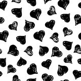 Hand drawn with ink seamless pattern with black hearts. Abstract grunge seamless pattern. Stock Photos