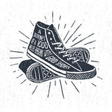 Hand drawn inspirational travelling badge with sneakers. Hand drawn textured vintage label, retro badge with sneakers vector illustration and inspirational royalty free illustration