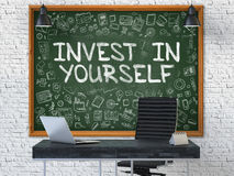 Hand Drawn Invest in Yourself on Office Chalkboard. 3D. Royalty Free Stock Image