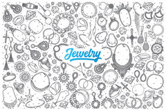 Hand drawn Jewelry doodle set with lettering. Hand drawn Jewelry doodle set background with blue lettering in vector Stock Images