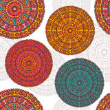 Hand drawn lace mandalas seamless pattern in motley tones. All objects are conveniently grouped and are easily editable stock illustration