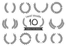 Hand Drawn Laurel Wreaths. 10 Hand drawn laurel wreaths on white background stock illustration