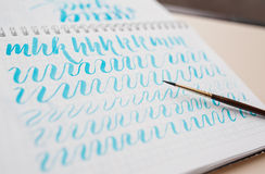 Hand drawn lettering background. Lettering brush calligraphy on paper.  Royalty Free Stock Photo