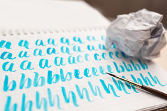 Hand drawn lettering background. Lettering brush calligraphy on paper Stock Photography