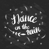 Hand-drawn lettering Dance in the rain with flowers Stock Photos