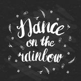 Hand-drawn lettering Dance on the rainbow with flowers Royalty Free Stock Photography