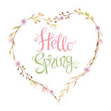 Hand drawn lettering Hello Spring in the shape of a heart Stock Image