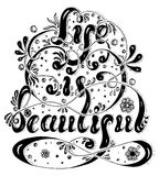 Hand drawn lettering Life is beautiful with flowers, spray and swirls Stock Photo