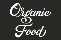Hand drawn lettering Organic Food. Vector Ink illustration. Typography poster on black background. Organic, natural stock illustration