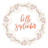 Hand drawn lettering phrase hello september. Hand drawn typography lettering phrase Hello September isolated on the white background with wreath for photo Royalty Free Stock Images