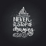 Hand Drawn lettering of a phrase Never Stop Dreaming. Stock Photo