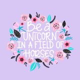 Hand drawn lettering quote - Be a unicorn in a field of horses. Modern calligraphy for cards, t-shirts, posters, mugs stock illustration