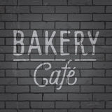 Hand drawn lettering slogan on brick wall background Royalty Free Stock Image