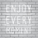 Hand drawn lettering slogan on brick wall background Stock Images