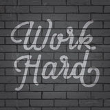 Hand drawn lettering slogan on brick wall background Royalty Free Stock Photography