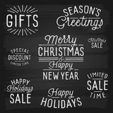 Hand drawn lettering slogans for Christmas and New Year Stock Photo